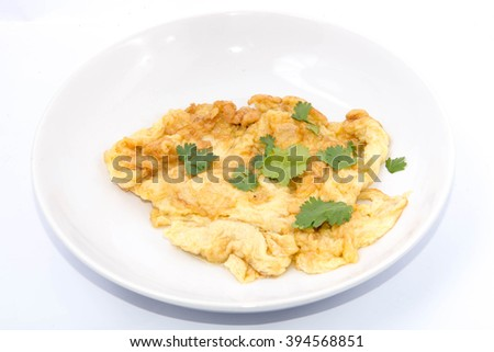Omelet on a white plate, white background