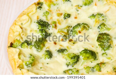 omelet with cheese and broccoli on a white plate