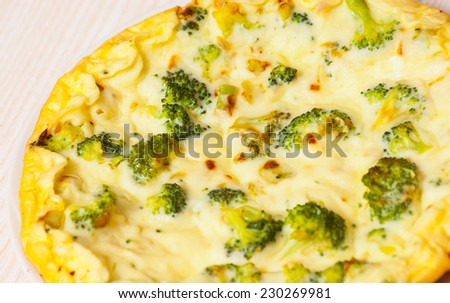 omelet with cheese and broccoli on a white plate - stock photo