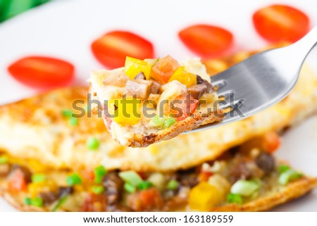 Omelet with diced vegetables - stock photo