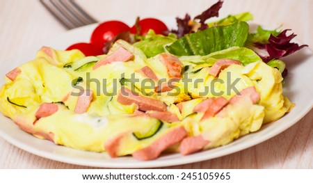 omelet with ham and zucchini - stock photo