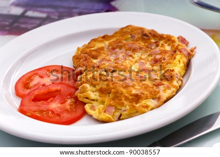 Omelet with ham & Tomato - stock photo