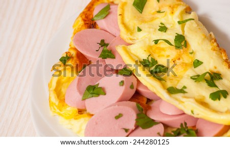 omelet with sausage - stock photo