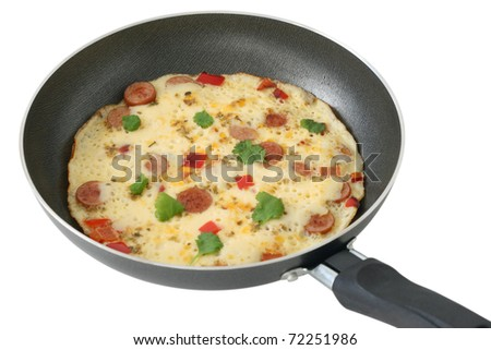 omelet with sausages and pepper - stock photo