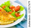Omelet with vegetable salad - stock photo