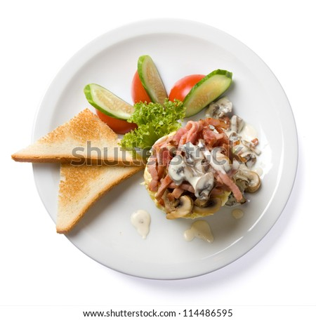 omelette with ham and mushrooms isolated top view, with clipping path - stock photo