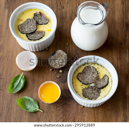 Omelette with ingredients  on the wooden table .Top view. - stock photo