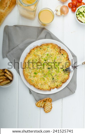 Omelette with zucchini and mozzarella cheese, scallions, fresh orange juice and crispy toast - stock photo