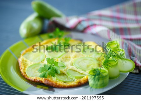 omelette with zucchini in a bowl on the table