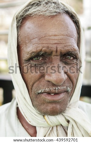 Omkareshwar, Madhya Pradesh - May 24 2016: Old man with tanned and wrinkled face  looks to  the camera at Omkareshwar, Madhya Pradesh,India.