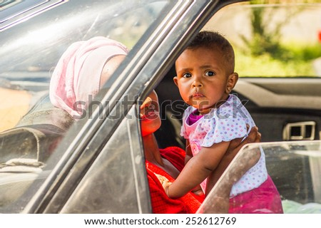 OMO, ETHIOPIA - SEPTEMBER 21, 2011: Unidentified Ethiopian boy with his mother in the car. People in Ethiopia suffer of poverty due to the unstable situation