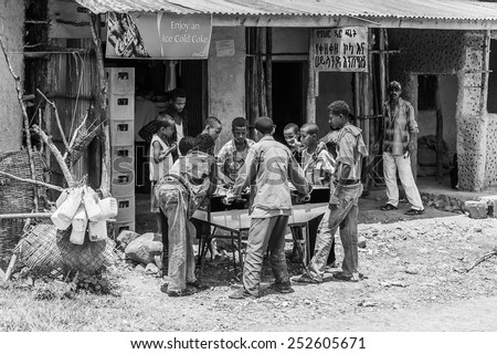 OMO, ETHIOPIA - SEPTEMBER 19, 2011: Unidentified Ethiopian boys play table football. People in Ethiopia suffer of poverty due to the unstable situation