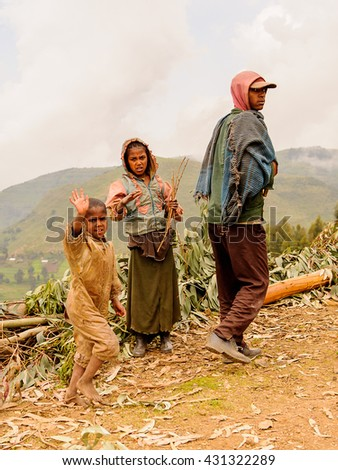 OMO, ETHIOPIA - SEPTEMBER 21, 2011: Unidentified Ethiopian family. People in Ethiopia suffer of poverty due to the unstable situation