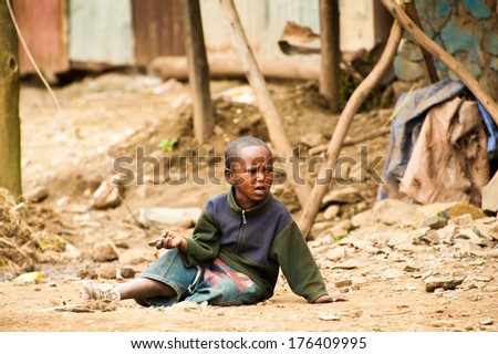 OMO, ETHIOPIA - SEPTEMBER 22, 2011: Unidentified Ethiopian little boy plays with the stones. People in Ethiopia suffer of poverty due to the unstable situation - stock photo