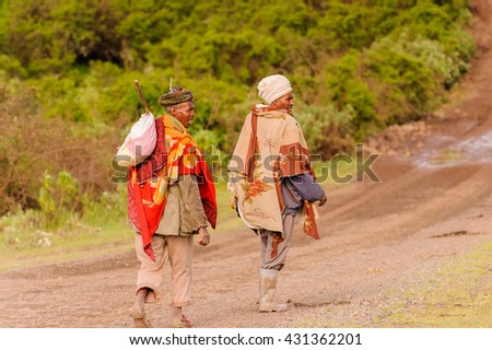OMO, ETHIOPIA - SEPTEMBER 21, 2011: Unidentified Ethiopian men on the road. People in Ethiopia suffer of poverty due to the unstable situation - stock photo