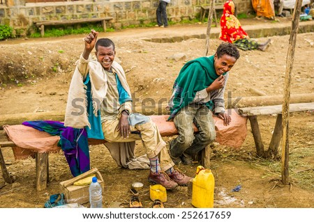 OMO, ETHIOPIA - SEPTEMBER 21, 2011: Unidentified Ethiopian men smile in the street. People in Ethiopia suffer of poverty due to the unstable situation