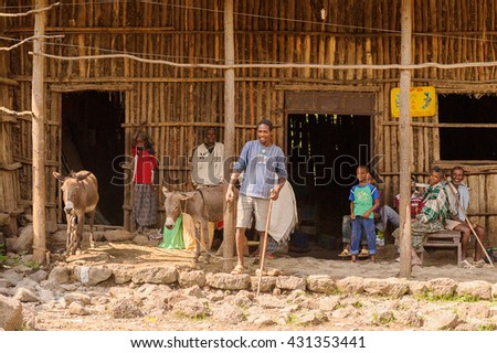 OMO, ETHIOPIA - SEPTEMBER 19, 2011: Unidentified Ethiopian people in the street. People in Ethiopia suffer of poverty due to the unstable situation - stock photo
