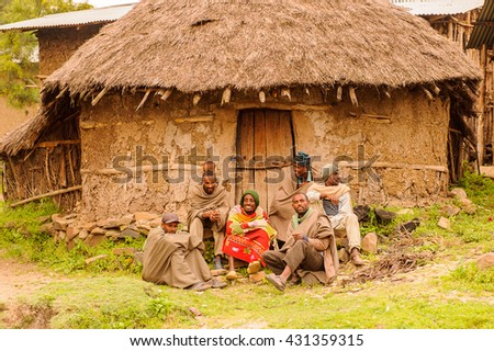 OMO, ETHIOPIA - SEPTEMBER 21, 2011: Unidentified Ethiopian people near a house. People in Ethiopia suffer of poverty due to the unstable situation - stock photo