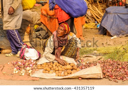 OMO, ETHIOPIA - SEPTEMBER 21, 2011: Unidentified Ethiopian woman sells potatoes. People in Ethiopia suffer of poverty due to the unstable situation - stock photo