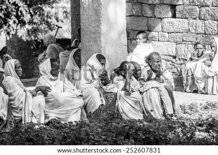 OMO, ETHIOPIA - SEPTEMBER 21, 2011: Unidentified Ethiopian women in white tissue. People in Ethiopia suffer of poverty due to the unstable situation