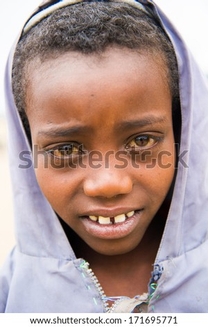 OMO VALLEY, ETHIOPIA - SEP 22, 2011: Unidentified Ethiopian boy poses for camera smiling in Ethiopia, Sep.22, 2011. People in Ethiopia suffer of poverty due to the unstable situation