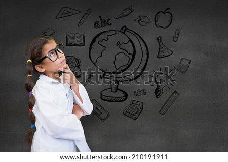 omposite image of cute pupil dressed up as scientist against black wall - stock photo