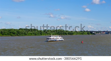 Omsk, Russia - June 28, 2010: summer view of Irtysh river with floating pleasure boat