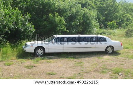 Omsk, Russia - May 28, 2016: white limousine at bushes