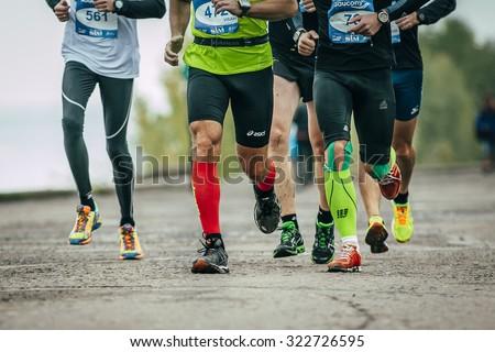 Omsk, Russia -  September 20, 2015: group of athletes running along the embankment during Siberian international marathon - stock photo