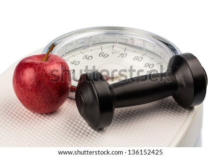 on a bathroom scale is an apple. symbolic photo for weight loss and healthy, vitamin-rich diet. - stock photo