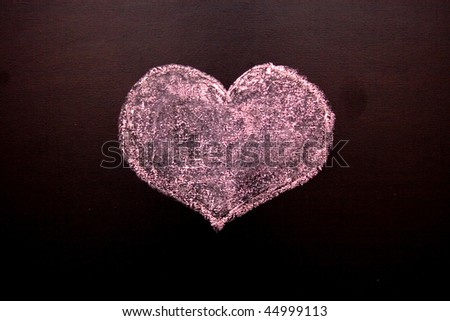 On a blackboard red heart, and a word love is drawn - stock photo