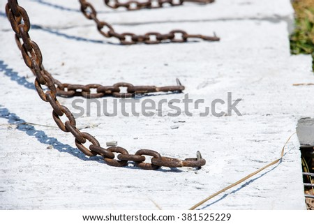 On a chain to lift slabs. - stock photo
