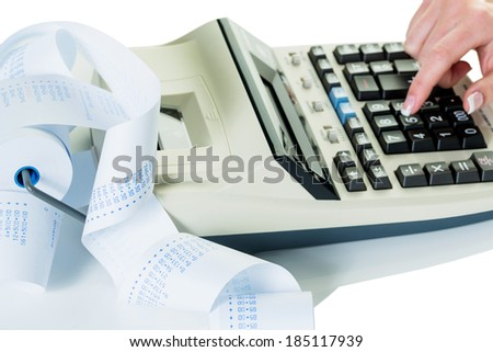 on a desk is a calculator. with arithmetic strip - stock photo