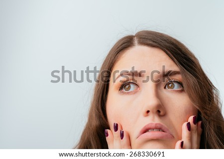 on a gray background young girl tired - stock photo