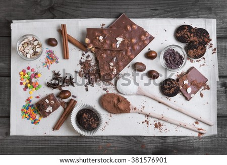 On a gray wooden background in rustic style ingredients for chocolate dessert preparation, top view - stock photo