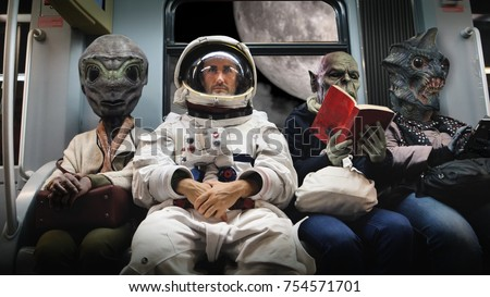 On A Spaceship An Astronaut Sitting Alongside Extraterrestrial Monsters Travel In Total Relaxation