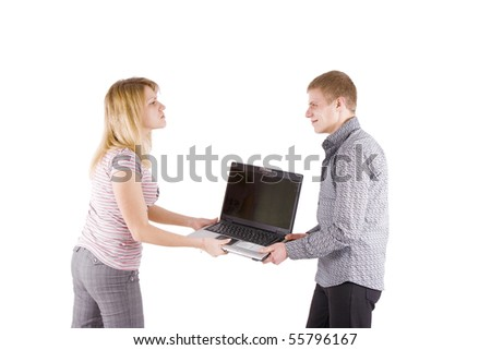 on a white background a man and a woman fighting for laptop - stock photo