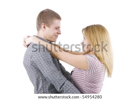on a white background happy young couple hugging