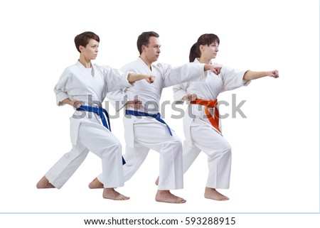 On a white background three sportsmen are training punch arm