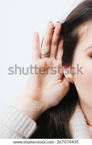 on a white background young girl with long hair overhears - stock photo
