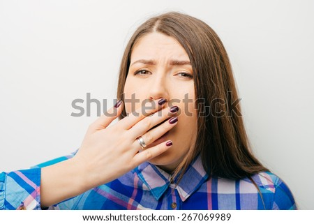 on a white background young girl yawns - stock photo