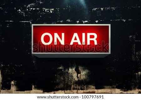 ON AIR board message is lit on in studio - stock photo