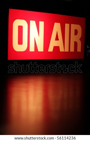 On-Air studio sign glowing with red reflection.