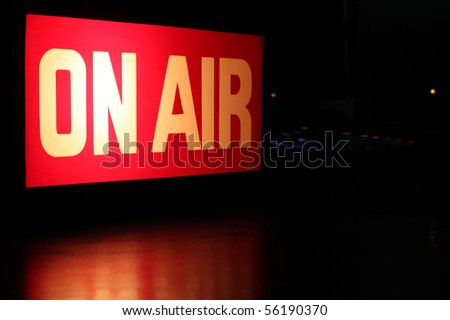 On-Air studio sign glowing with red reflection and copy space.