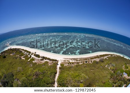 On Amadee Island just off New Caledonia, visitors can climb to the top of a lighthouse and get a beautiful view of the surrounding reef and lagoon. - stock photo