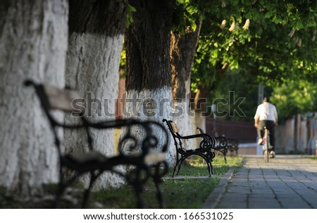On bike in the park - stock photo