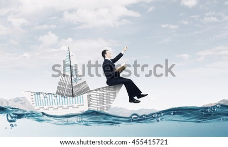 On board of paper ship . Mixed media - stock photo