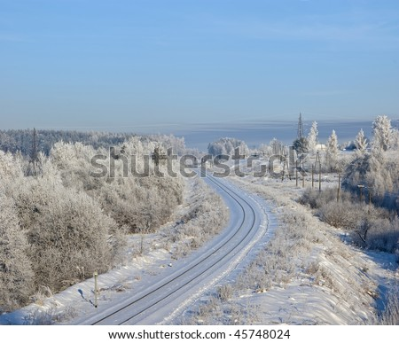 On branches plentiful hoarfrost. The shining sun shines behind. Near to small town. The railway - stock photo