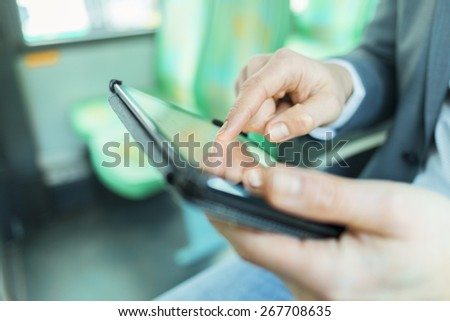 On bus man using digital tablet. Reading emails. texting message. Close-up hands - stock photo