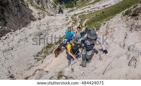 On circular hike around Sass de Putia mountain-August 15, 2016: Hikers straining while scaling the steep ascent & scrambling on the way up to Putia mountain pass (Forcella di Putia), Dolomites, Italy